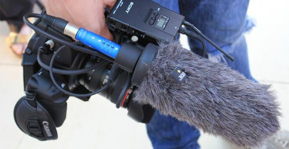 Man holding camera with shotgun mic