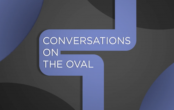 Conversations on the Oval with blue and black abstract designs