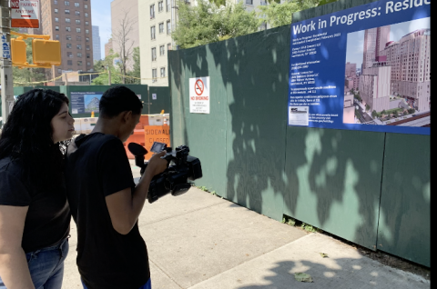 youth producers filming in neighborhood under construction